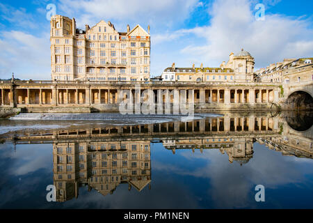 Pultney Bridge with reflections in the water down in the weir - Stock Photo