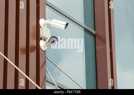 CCTV cameras on the wall of the building - Stock Photo