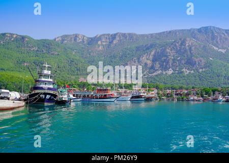 Akyaka, Mugla/Turkey - August 15 2018: Daily tours, Akyaka village and mountain in the background. - Stock Photo