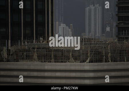 Hong Kong, China. 17th Sep, 2018. Broken bamboo scaffoldings and torn out covers are seen here after Super Typhoon MANGKHUT left Hong Kong this morning leaving wide spread damages to the territory. Sept-17, 2018 Hong Kong.ZUMA/Liau Chung-ren Credit: Liau Chung-ren/ZUMA Wire/Alamy Live News - Stock Photo