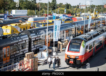 17 September 2018, Berlin: Several trains stand next to each other on the track and open-air grounds of the InnoTrans traffic technology trade fair at Messe Berlin. From 18.09.2018, all innovations in traffic technology will be presented at InnoTrans in 41 halls and on an open-air site with 3,500 running metres of rails. Photo: Fabian Sommer/dpa - Stock Photo