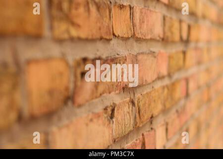 brick stone wall in yellow - Stock Photo