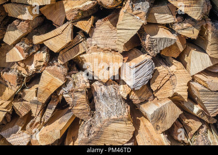 Stack of firewood, background stack of wood. Dry chopped firewood logs ready for winter - Stock Photo