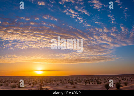 Sunset in the desert in South Tunisia - Stock Photo