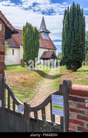 Surrey heritage: Medieval Wisley Church and churchyard with yew trees in the village of Wisley, Surrey, UK dating back to Norman times in about 1150 - Stock Photo