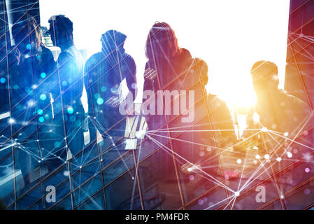 Business people work together in office with internet network effects. Concept of teamwork and partnership. double exposure - Stock Photo
