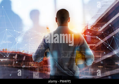 Businessman Architect analyzes the works of a building. double exposure - Stock Photo