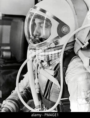 Profile of astronaut Alan Shepard in his silver pressure suit with the helmet visor closed as he prepares for his upcoming Mercury-Redstone 3 (MR-3) launch. On May 5th 1961, Alan B. Shepard Jr. became the first American to fly into space. His Freedom 7 Mercury capsule flew a suborbital trajectory lasting 15 minutes 22 seconds. His spacecraft splashed down in the Atlantic Ocean where he and Freedom 7 were recovered by helicopter and transported to the awaiting aircraft carrier U.S.S. Lake Champlain.    File Reference # 1001 008THA - Stock Photo