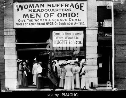 Woman suffrage headquarters in Upper Euclid Avenue, Cleveland--A. (at extreme right) is Miss  Belle Sherwin, President, National League of Women Voters; B. is Judge Florence E. Allen  (holding the flag); C. is Mrs. Malcolm McBride, 1912.  File Reference # 1003 023THA - Stock Photo
