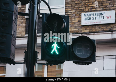 London, UK - July 26, 2018: Green pedestrian light on Marylebone Road, City of Westminster, London borough which occupies much of the central area of  - Stock Photo