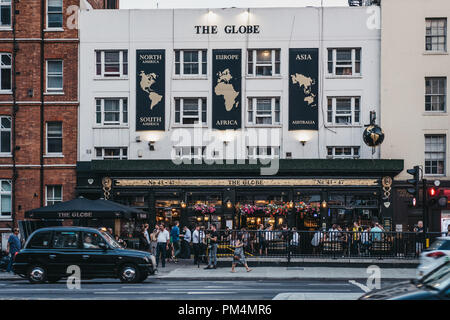 London, UK - July 24, 2018: People drinking outside The Globe pub in Marylebone, London, the area famous for Madame Tussauds waxwork museum and the Sh - Stock Photo