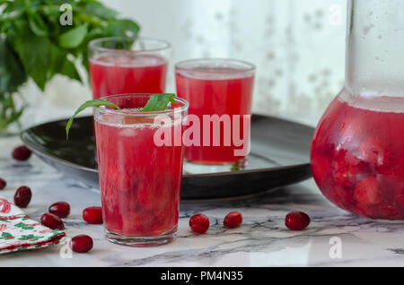 Fresh cranberry drink on marble background.Ready to serve. - Stock Photo