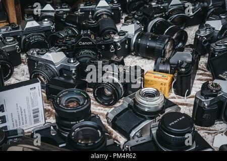 London, UK - July 21, 2018: Selection of old film cameras on sale at Portobello Road Market, Notting Hill, London. Portobello Road is the world's larg - Stock Photo