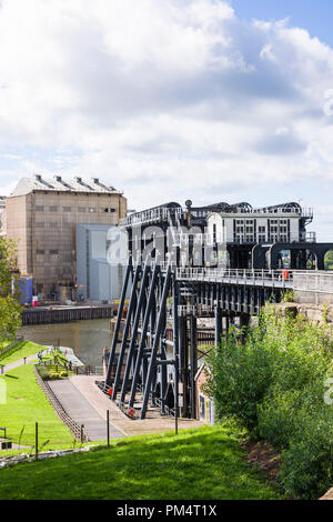 Higher level view of the Anderton Boat lift and River Weaver from the higher ground supporting a spur of the Trent & Mersey canal in Northwich Cheshir - Stock Photo