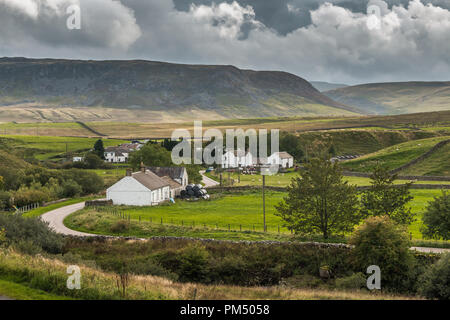 North Pennines AONB Landscape. The remote farming hamlet of Langdon Beck, Upper Teesdale, UK in evening sunshine - Stock Photo