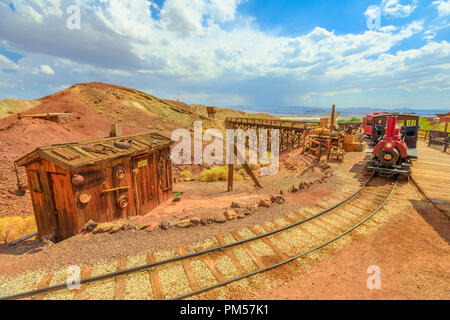 Heritage railroad in historic ghost town. Old steam train tour through old silver mines in Calico abandoned town. Calico Mountains of Mojave Desert region of Southern California, Unites States. - Stock Photo