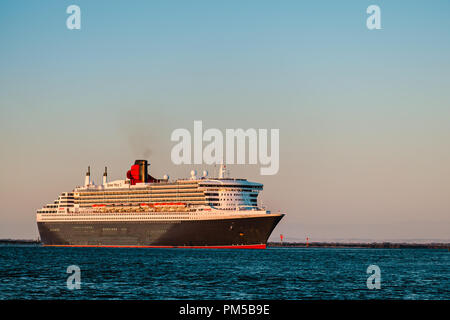 Adelaide, Australia - February 16, 2018: Cruise ship Queen Mary 2 with people on board departing from Outer Harbour in Port Adelaide - Stock Photo