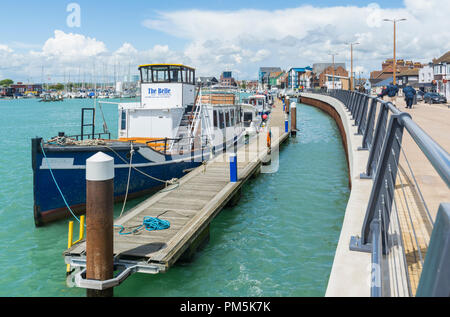 The Belle and other boats moored up on the River Arun at high tide in Spring in Littlehampton, West Sussex, England, UK. - Stock Photo