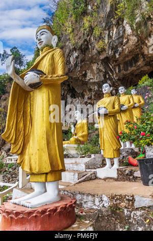 Buddha Statues at the entrance to Yathaypyan Cave, Hpa An, Myanamar - Stock Photo