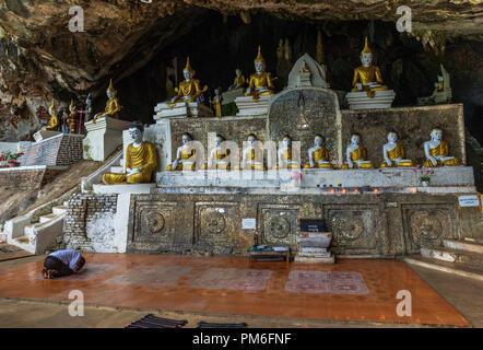 Row of Buddha statues inside sacred Ya The Pyan Cave in Hpa-An, Myanmar (Burma). - Stock Photo