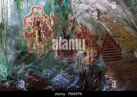 Ancient decor of the Ya The Pyan cave in Hpa-An, Myanmar - Stock Photo