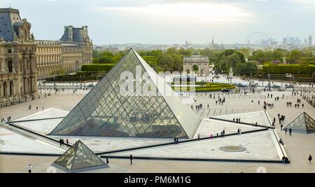 Many tourists walking in Louvre, Carrousel Arc de Triomphe, Paris, France. - Stock Photo