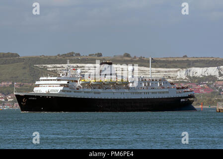 MV Astoria departing Portsmouth Harbour,England UK.  Background of Portsdown Hill and chalk cliffs. Came into service in 1946 and is the second oldest - Stock Photo