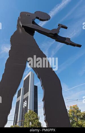the sculpture, hammering man, designed by jonathan borofsky, near frankfurt exhibition area, frankfurt am main, germany. - Stock Photo