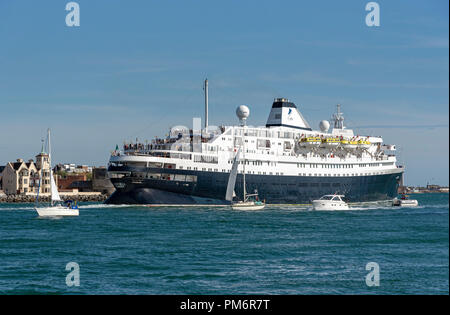 MV Astoria departing Portsmouth Harbour, England UK. She came into service in 1946 and is the second oldest cruise ship in service. - Stock Photo