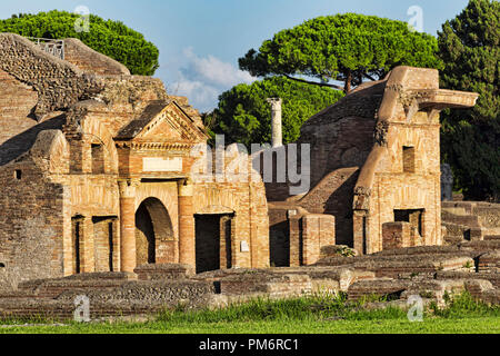 Landscape in Ancient Ostia ruins with the main building of  Epagathiana and Epafrodito Horrea and the entrance to the  public warehouses - Rome - Stock Photo