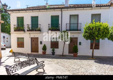 Spain, Ronda - 21 June 2017: EXTERIOR OF BUILDING along side cobblestone street - Stock Photo