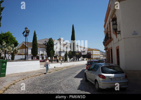 Spain, Ronda - 21 June 2017: CARS ON ROAD BY BUILDINGS AGAINST SKY IN CITY - Stock Photo