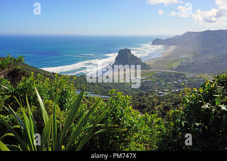 View of the black sand Piha Beach near Auckland in the North Island, New Zealand - Stock Photo