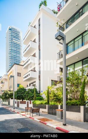 Israel, Tel Aviv - 8 September 2018: Bauhaus building on Yavne street and Meier on Rothshild skyscraper in the background - Stock Photo