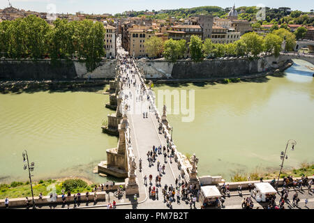 Rome, Italy, April 17th 2017: people walking on the Sant'Angelo bridge along the River Tiber in Rome. The bridge was built by Emperor Hadrian in 134 t - Stock Photo