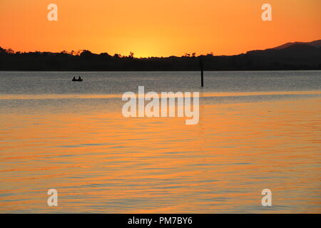 Fisching boat during sunset at Jacksons Bay - New Zealand - Stock Photo