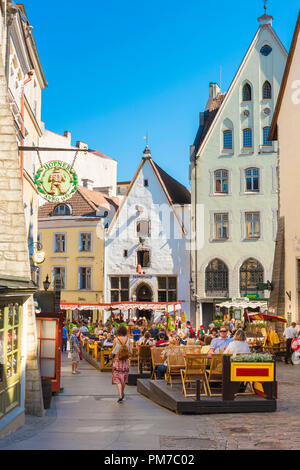 Tallinn restaurant, view of people sitting at restaurant tables on a summer afternoon along Vanaturu kael in the medieval Tallinn Old Town, Estonia. - Stock Photo