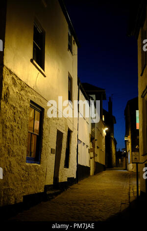 Narrow street at night in St Ives in Cornwall - Stock Photo