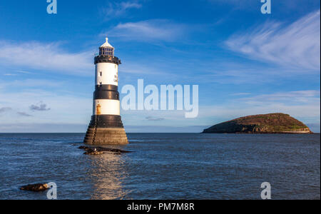 The Trwyn Du or Penmon Lighthouse on the Menai Straits, Anglesey, Wales - Stock Photo