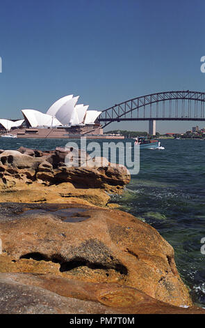 The Harbour Bridge and Opera House from Mrs. Macquaries Point, Sydney, NSW, Australia - Stock Photo
