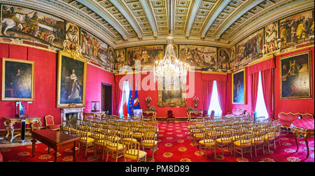 VALLETTA, MALTA - JUNE 17, 2018: Panorama of Ambassador's Room of Grandmaster's Palace in red gamma with vintage frescoes and paintings, on June 17 in - Stock Photo
