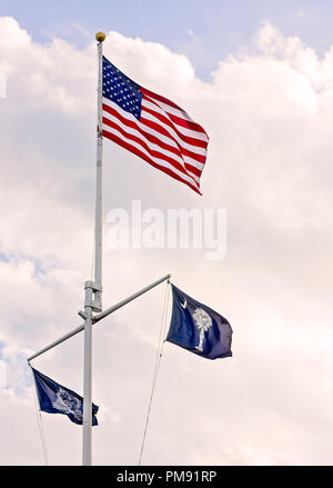 The American flag flies above the City of Charleston flag and the South Carolina state flag, April 5, 2015, in Charleston, South Carolina. - Stock Photo