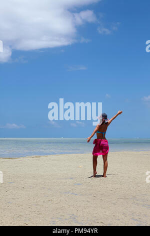 Girl on the beach of Ile aux Benitiers, Mauritius