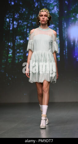 London, London, UK. 14th Sep, 2018. A model walks the runway at the based Turkish designer BoraAksu during London Fashion Week September 2018 at BFC Show Space. Credit: Rahman Hassani/SOPA Images/ZUMA Wire/Alamy Live News - Stock Photo