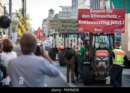 18 September 2018, Berlin: Several tractors are on the campaign 'tractor against lignite' by the organisation 'Campact' in front of the Federal Ministry of Economics. Before today's meeting of the Coal Commission, the activists protest against the deforestation by RWE in the Hambach forest and call for the immediate phasing out of coal. Photo: Fabian Sommer/dpa - Stock Photo