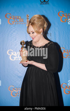 "After winning the category of BEST ORIGINAL SONG – MOTION PICTURE for ""SKYFALL"" for ""SKYFALL"" - Lyrics By: Adele and Paul Epworth and Music By: Adele and Paul Epworth - Adele poses with the award backstage in the press room at the 70th Annual Golden Globe Awards at the Beverly Hilton in Beverly Hills, CA on Sunday, January 13, 2013. - Stock Photo"