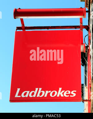 Ladbrokes, Betting shop, sign, logo, England, UK - Stock Photo