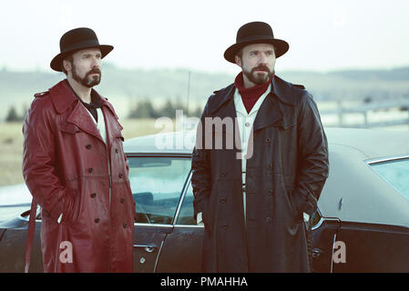 FARGO -- 'Before The Law' -- Episode 202 (Airs October 19, 10:00 pm e/p) Pictured: (l-r) Brad Mann as Gale Kitchen, Todd Mann as Wayne Kitchen. - Stock Photo