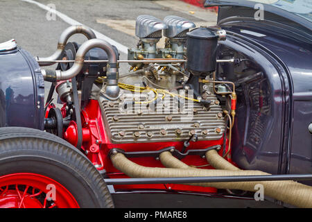 Closeup view of an Offenhauser engine mounted in a hot rod. - Stock Photo