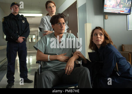 (Center l-r) JOHNNY DEPP as Will Caster and REBECCA HALL as Evelyn Caster in Alcon Entertainment's sci-fi thriller 'TRANSCENDENCE,' a Warner Bros. Pictures release. - Stock Photo